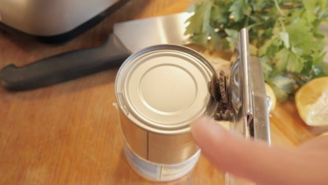 proper way to use a can opener