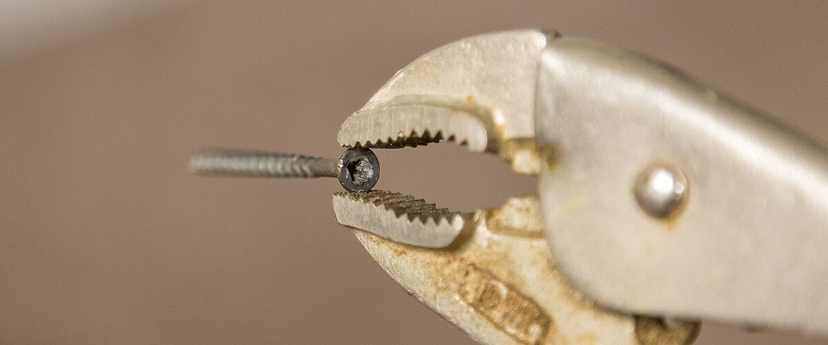Use a plier to take the screw out